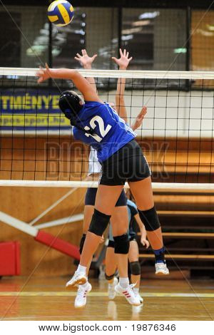 KAPOSVAR, HUNGARY - SEPTEMBER 20: Keppel (12) in action at the Hungarian Extra League woman volleyball game Kaposvar vs Palota, September 20, 2009 in Kaposvar, Hungary