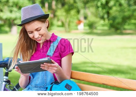 Gorgeous young hipster woman smiling while surfing internet on her digital tablet copyspace education online shopping browsing wifi wireless connection 3g 4g technology relax lifestyle positivity.