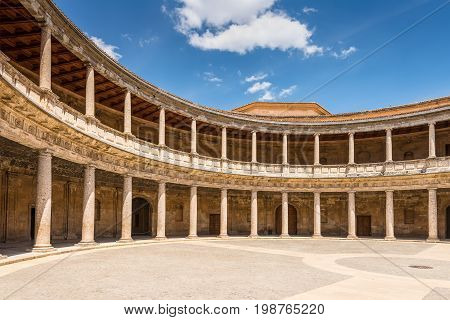 Granada Spain - May 19 2014: Courtyard at the Palace of Charles V (Palacio de Carlos V) without people in Alhambra in Granada Andalusia Spain.