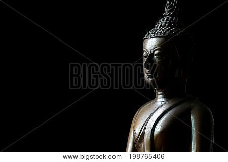 Buddha Statue on Black Background with Space for Text
