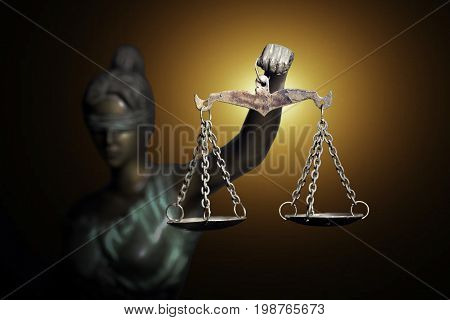 Lady Justice on golden background (Symbol of justice)