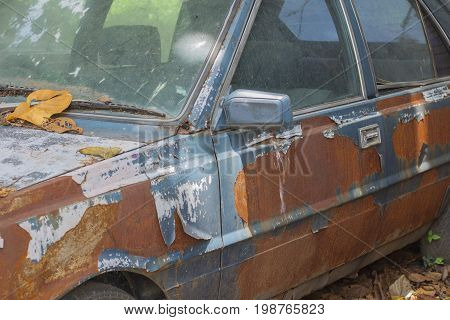 Background old car corroded rusty metal wall painted white background with metal rust stains rust car rust stains .
