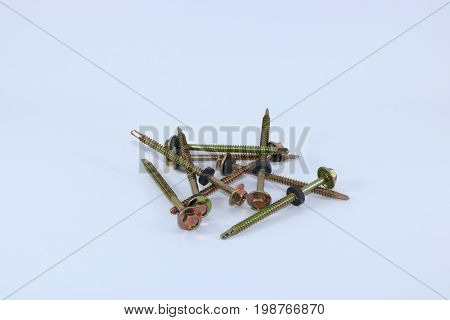 A pile of self drilling screws for fibre cement roof isolated on white background