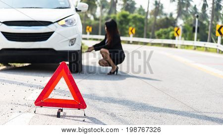 photo of businesswoman with flat tire,Woman drives the car