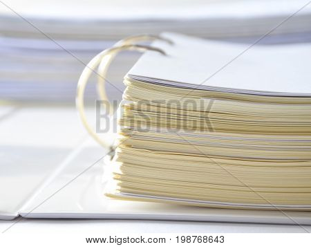 Stack of financial documents in document file on white table at workplace,business soncept.