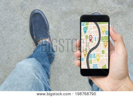 hand holding smart phone with map gps navigation application. concept guideline street travel