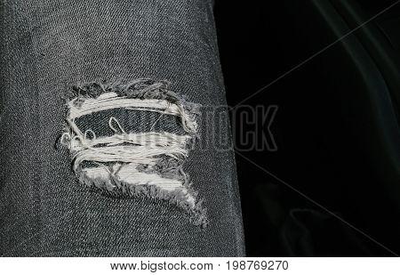 Black color Jeans lack detail White thread