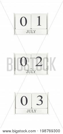 Closeup group of white wooden calendar with black 1 july 2 july 3 july word three date calendar isolated on white background