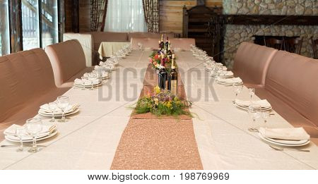 Beige Serviette On White Empty Plate On Dinner Table In Blur. Table Setting In Restaurant, Selective