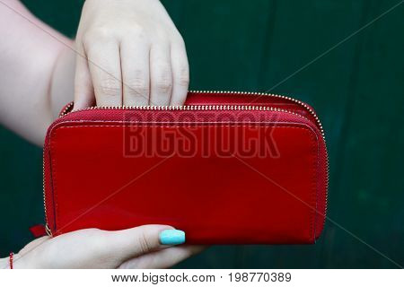 Big red purse in the hands of a girl
