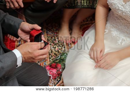 Groom holding box with wedding ring. Concept of marriage