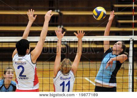 KAPOSVAR, HUNGARY - OCTOBER 11: Gabriella Kondor (13) strikes the ball at the Hungarian NB I. League woman volleyball game Kaposvar vs Veszprem, October 11, 2009 in Kaposvar, Hungary.