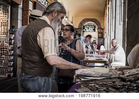 Madrid, Spain - August 6, 2017 - The emblematic Plaza Mayor of Madrid is filled with stalls selling old coins and stamps
