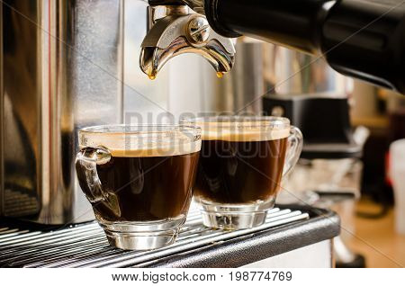 Two cups of hot coffee made from espresso machine ready for drink in the coffee shop