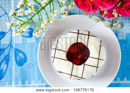 Sweet donut decorated with jam jelly on top ready for eating