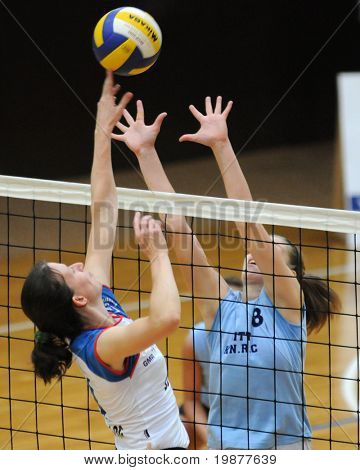 KAPOSVAR, HUNGARY - OCTOBER 25: Zacharne (L), Timea Kondor (R) in action at the Hungarian NB I. League woman volleyball game Kaposvar vs Eger, October 25, 2009 in Kaposvar, Hungary.