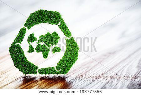 Green world sustainable development symbol on wooden desk. 3d illustration.