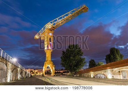 The gigantic yellow crane Titan used before for shipyards in Nantes, France