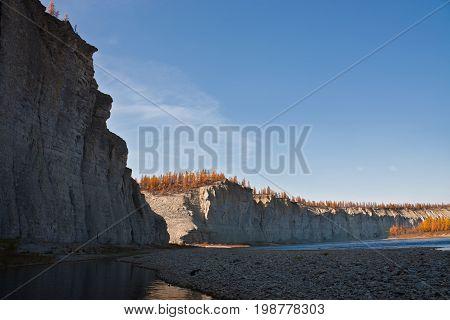 The rocky shores of the siberian taiga fall river during rafting and fishing. Moiyero river Evenkia Krasnoyarsk region Russia