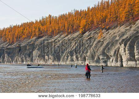 Fishermen on the Siberian taiga river in autumn in the North of Krasnoyarsk region. Fishing on the river Moierokan in Evenkia. Russia
