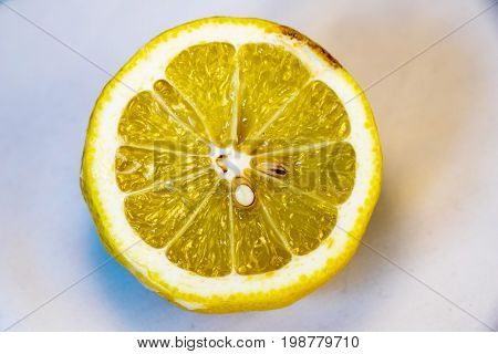 not fresh yellow lemon with white and blue background