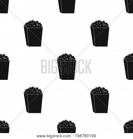 Popcorn in a blue box. Food for an amusement park and a movie trip.Amusement park single icon in black style vector symbol stock web illustration.