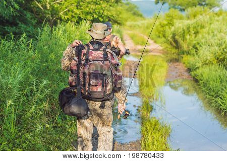 Fishermen Go Fishing With Fishing Rods In Their Hands