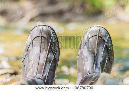Man S Foot In Rubber Boots. Rubber Boots Of The Fisherman