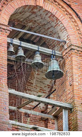 Russian church bells in the bell tower of the Church of the Assumption of the Blessed Virgin in the village of Berezovsky Ryadok, Russia.