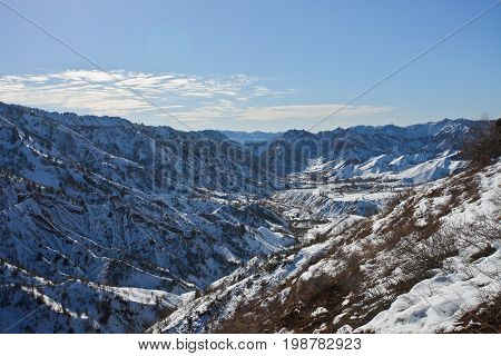 Mountain landscape in the valley of Sarikhosor after the winter snowfall. Tajikistan