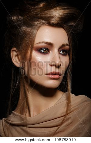 beautiful young woman with smoky eye make up. beauty portrait on black background.