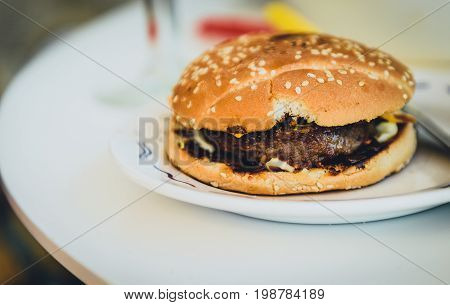 Home Made Burgers On A Plate On Caffe Table.