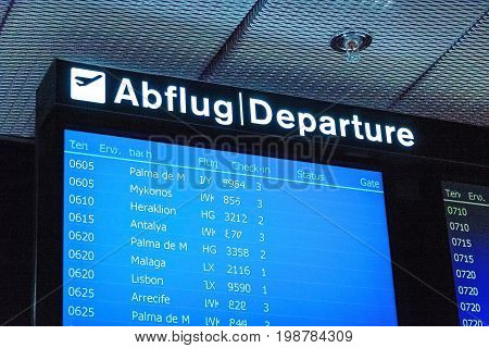 Zurich, Switzerland - June 11, 2017: Airport signboard Departure (Abflug) - at gate