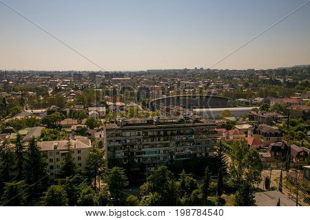 Evening aerial cityscape of Sukhum downtown, Abkhazia in summer
