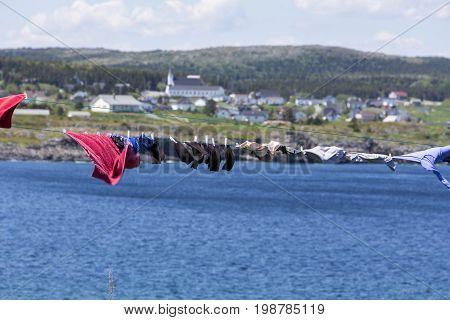 laundry drying on clothesline; windy day in Elliston, Newfoundland
