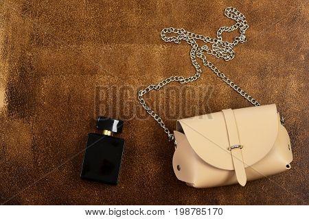 Beige Handbag With Chain And Perfume Bottle