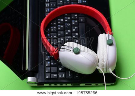 Music And Digital Equipment Concept. Electronics On Light Green Background
