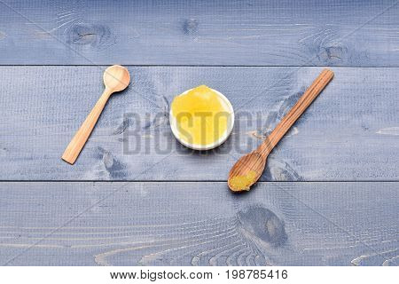 Cup Of Honey On Blue Vintage Background, Top View