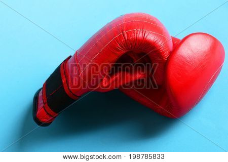 Boxing Gloves In Red Color. Sport Equipment On Blue