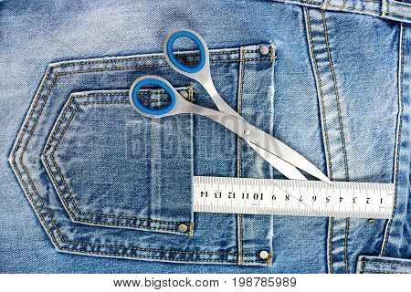 Metal Scissors And Ruler In Denim Pants Pockets, Top View