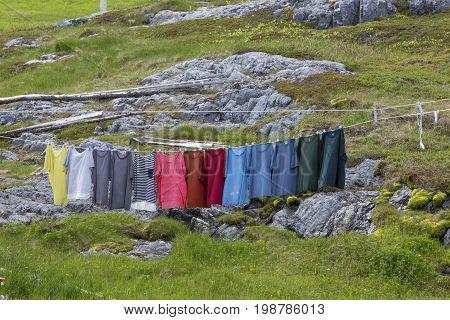 colorful shirts hanging on clothesline; Fogo Island, Newfoundland