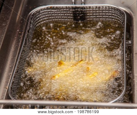 cooking potatoes in boiling oil in deep fried