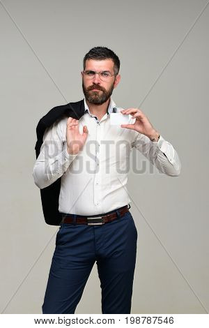 Guy With Jacket On Shoulder And Business Card, Copy Space