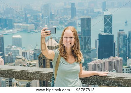 Hong Kong Victoria Peak Woman Taking Selfie Stick Picture Photo With Smartphone Enjoying View Over V