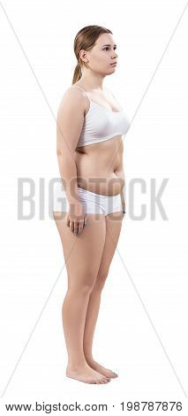 Full length portrait of overweight young woman isolated on white background. Diet concept