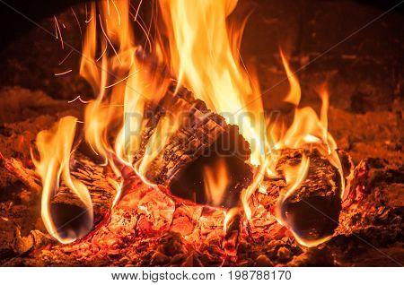 A Closeup Of A Burning Firewoods