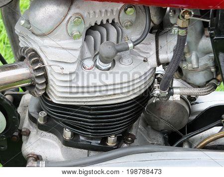 engine of vintage british motorcycle showing cylinders and spark plugs