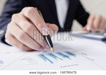Businessmen working with graph data at officeFinance managers taskConcept business and finance investment