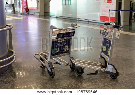 Handcarts for luggage at the international airport Vnukovo (Moscow) - July 2017.