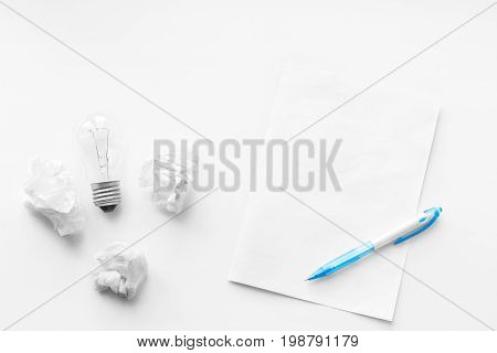 New business idea and innovation in trade. The concept of selling and buying. Pen blank sheet and crumpled sheets of paper on the wooden white background. Writing poetry. Never give up.